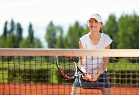 Young sportswoman on tennis training