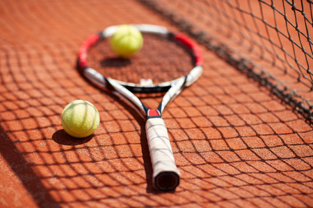 Close up of sport equipment for tennis on tennis court