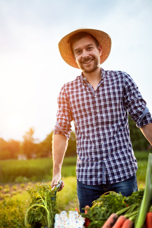 likable: Likable farmer with smile on work in garden Stock Photo