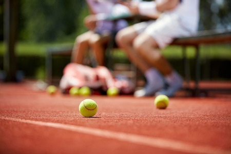 court: Yellow tennis balls during pause on tennis court