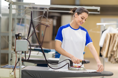 dry cleaner: Women iron on ironing board Stock Photo