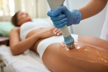 shockwave: Correction cellulite figures in the beauty salon acoustic wave therapy
