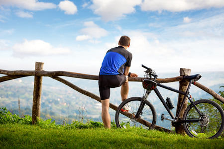 mtb: Young cyclists relaxing and looking at the beautiful view in front of you Stock Photo