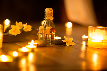cosmetic product: Spa massage setting with candlelight