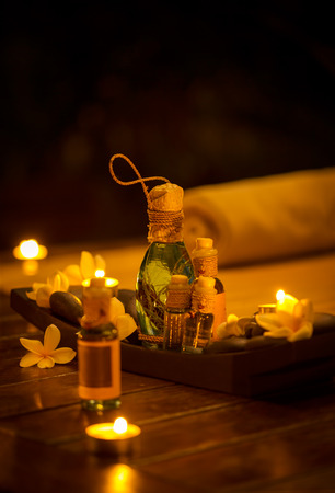 Bottles of massage oil, spa set with candles