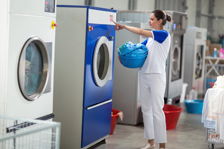 dry cleaners: Employees including washing machines in washing machine
