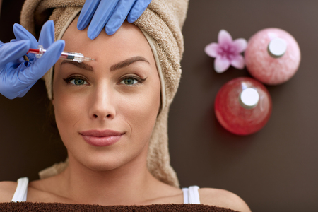 Beauty woman giving botox injections. botox, cosmetic treatments, wrinkle removal, Botox injections