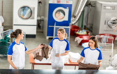 agrees: Smiling worker ads ironed other textile workers