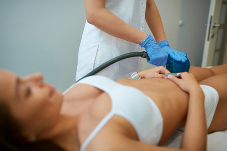 oscillation: cosmetic beauty with deep oscillation device treatment  at spa clinic