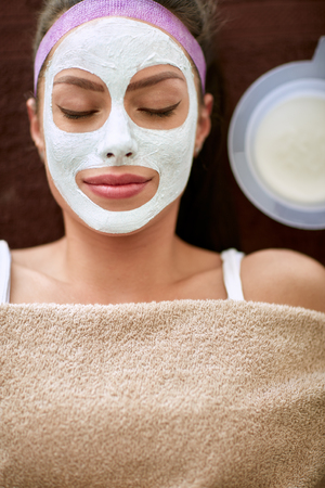 hydration: Serenity young woman with cosmetic hydration mask on her face