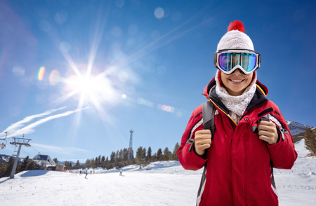 Portrait of smiling woman in ski outfit