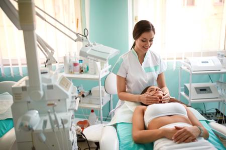 salon and spa: Spa face massage in spa salon, facial beauty treatment Stock Photo