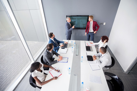 company director: Director of multiethnic company hold meeting with employees
