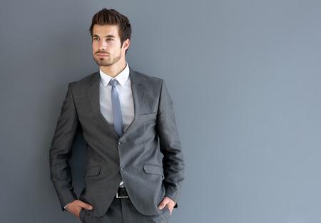 Young man in elegant man suit posing
