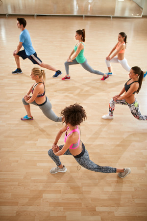 Top view on fitness class with exercisers in colorful sportswear