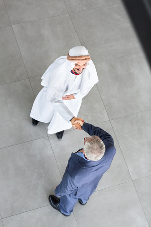 agal: Top view of Arabian partner and manager on entrance of company