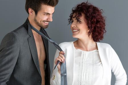 Attractive woman and man flirting