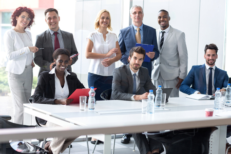 team from behind: Young multiethnic business team posing in company