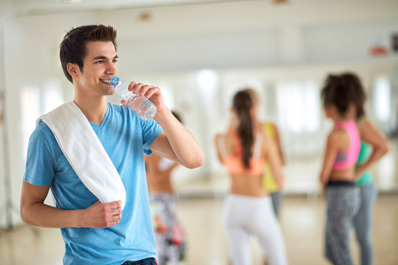or thirsty: Thirsty young man drink water after training