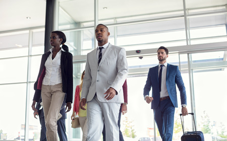 Black business people at airport