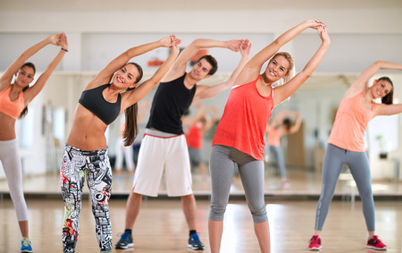 limbering: Young fitness group on training indoor