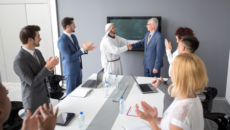 company director: Arabian partner with director of company made successful business and handshake