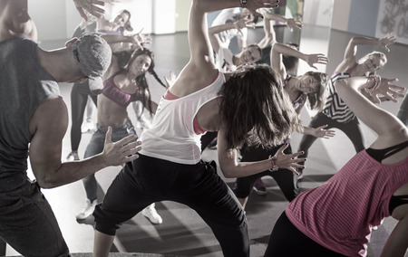 group of dancers at fitness training in studio