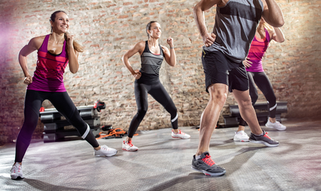 Group of young people doing exercise with music Stock Photo