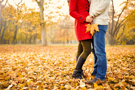 love park: Romance in autumn in park, young couple in love - concept