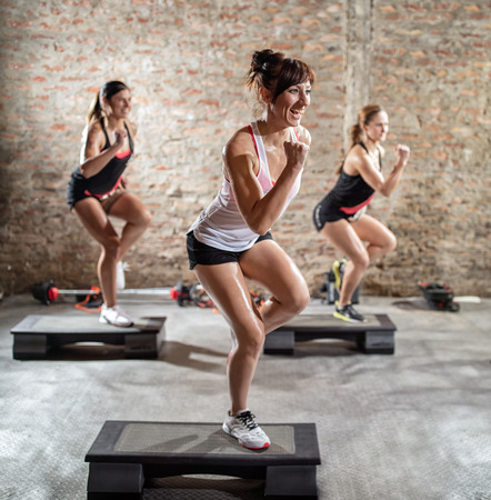 Group of young women  having  step training