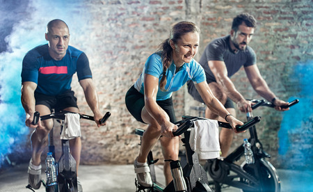 active people on cycling fitness class Stock Photo