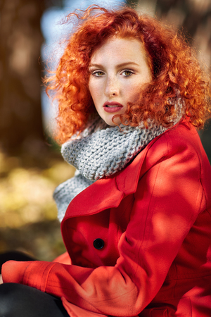 Portrait of young ginger curly girl