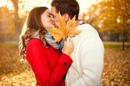 Young couple kissing with love in nature in autumn Banque d'images