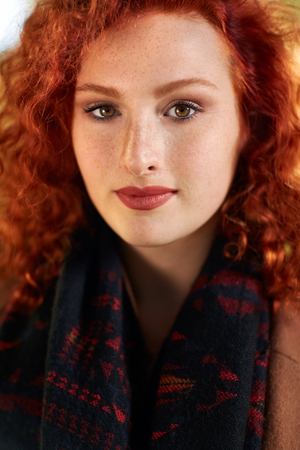 Portrait of young redhead woman