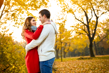 Romance between two young persons in autumn in nature photo