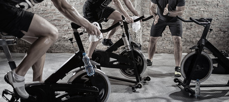 machine man: Cardio training on bicycle, sport and healthy lifestyle Stock Photo