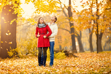 Man and woman in romance in park in autumn photo