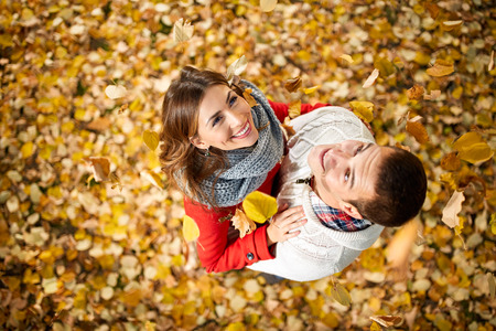 Top view of happy woman and man in love in park in autumn photo