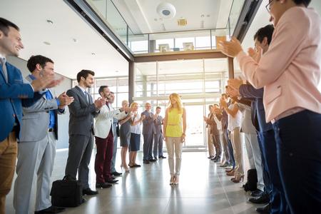 employer: smile employer applauding to happy confident leader Stock Photo