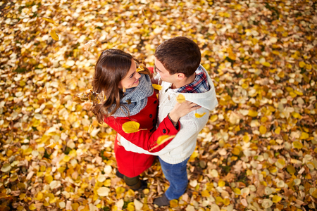 Hugging couple in love in park with yellow photo
