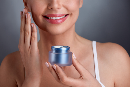 renewal: Beautiful middle-aged woman with renewal cream, cosmetic concept