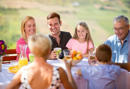 Picnic in garden with happy family outdoor Zdjęcie Seryjne