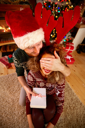 shinning: Christmas surprise from boyfriend to girlfriend Stock Photo