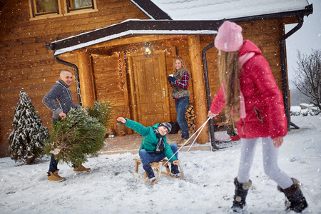 winter holiday: Family enjoying in winter eve- holiday season