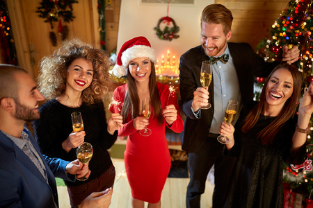 celebrate year: Cheerful friends celebrate New Year Stock Photo