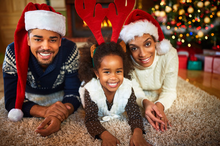 Happy smiling African American family in Christmas atmosphere