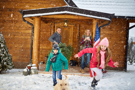 holiday spending: family, childhood, season, holidays and people concept - happy family in winter holiday