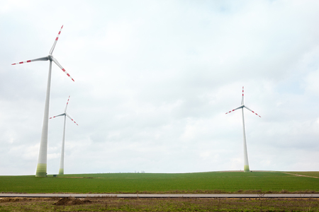 windy energy: Energy wind turbines on field