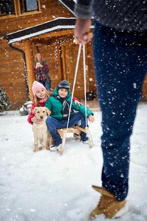 pappy: Winter, snow, family sledding at winter time- Family enjoying