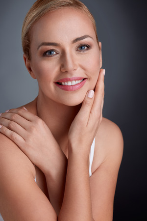 maturity:  Nice portrait of beautiful maturity woman with gentle tan  Stock Photo